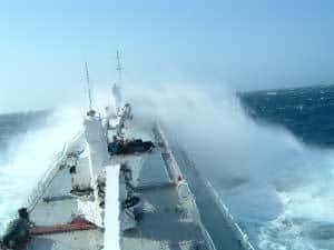big waves and large ship